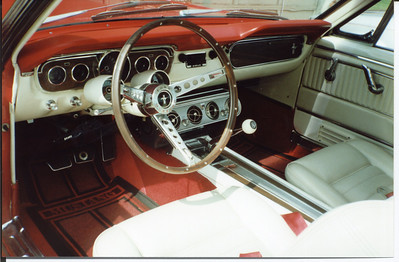 A shot of the interior.  Pony interior, wood steering wheel, console, Rally-Pac, under-dash air (this was how they came in 1965),  disc brakes, and a Hurst shifter mounted to a Toploader 4-speed are all visible.