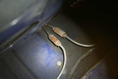"""Rear brake line couplers behind the """"swiss cheese"""" panel"""