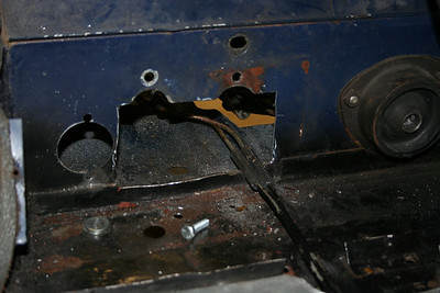 The gaping hole in the firewall after surgury with a cutting wheel