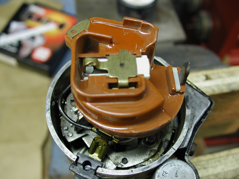 """""""This looks odd"""" you say? Yes, it is an ignition rotor out of *I think* a Porsche 911 (1965-69). It has a small weight that is held in place with a spring. As the rotor spins faster and faster the weight slides out and when the rotor hits 7100 rpm... it grounds out the coil and cuts the spark. A simple rev limiter!<br /> <br /> I plan on using either an MSD 6AL or a Pertronix Rev Limiter to go with this distributor so I will remove this rotor and replace it with a standard one."""