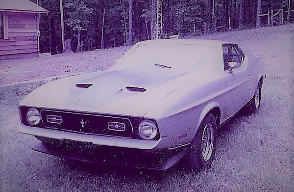 Photo taken in back yard of Russellville home about 1984. The car had just been completely restored to near mint condition. Car came factory equipped with 351-4V Cleveland, 4 speed manual transmission, limited slip rear end, Magnum 500 wheels, Deluxe interior with folding rear seat, tinted glass, PS, PB, Air Conditioning, PB AM radio,  Dual exhaust, floor console . This car was extremely fast, drove well, and was extremely reliable.