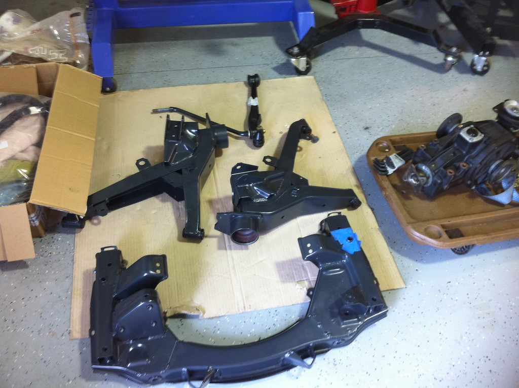 Freshly powder coated trailing arms and front subframe. Limited slip differential is on the creeper.
