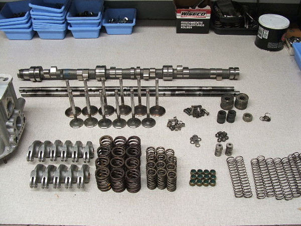 Henry at Powerplant racing begins the engine assembly. Polished rockers, dual valve springs and Dbilas camshaft.