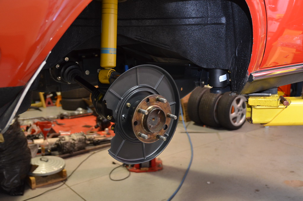 We had to use later axle stubs and backing plates for the ventilated rotors and their calipers.