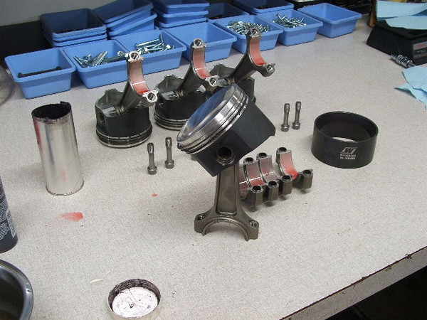 Assembly of lightweight forged pistons & rods.