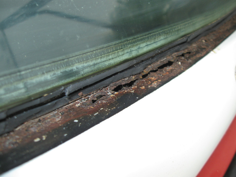 This was the first big 'uh-oh.' Rust straight through the lip that seals the bottom of the windshield to the body. This is a common area to rust out, but you can only find it by cutting the seal, something I didn't want to do until I owned the vehicle. This will need to be cut out and replaced. July 2012