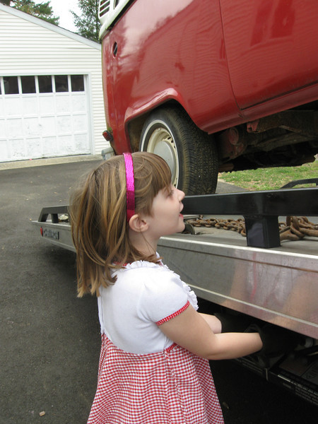 The flatbed that brought the vehicle saw how excited she was, and offered her his gloves so that she could unload the vehicle. (He's standing just out of frame in case something went wrong.) She followed instructions and put it down in the driveway, neat as you please.