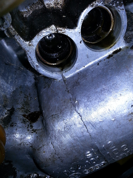 from a distance, this appears to be a crack. it is not. only the casting at the exhaust pushrod bore of cylinder 2