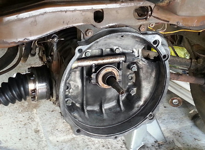 After the shifter linkage was replaced while the transmission was out, I reassembled using restored components where ever possible, since quality parts sources are drying up fast. The CV joints look quite glossy without a pound of grease and road tar on them. I figure the Bus is going to be at least 15 pounds lighter by the time it is roadable, I've removed so much dirt. April 07, 2012.