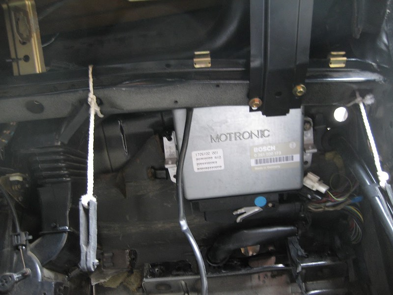 ECU location behind the glovebox. M8 bolts go up through the firewall with rubber isolating washers. There may be an issue with heat coming from the exhaust right here but mounting it the E30 way will require a shelf built to the dash support.