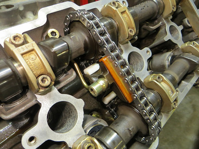 Tensioners and intake pieces