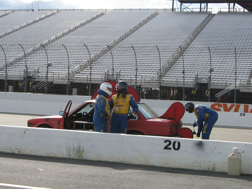 Doug Ingram and Christian Cormier during a driver change while Gary Lundgren handles the fueling.