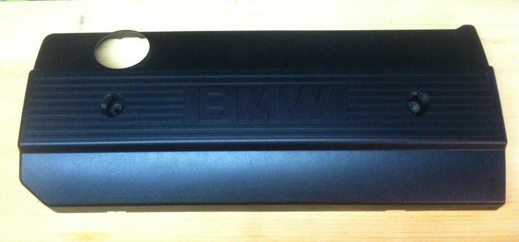 Plastic M50 valve cover after stripping and painting with Rustoleum black textured paint.