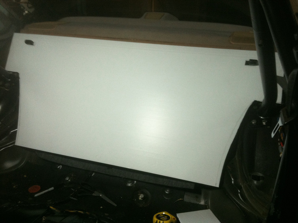 The seatback panel, made from corrugated plastic. There's still some more trimming to do so it meets the shelf at the bottom. And it will be covered in black carpet.