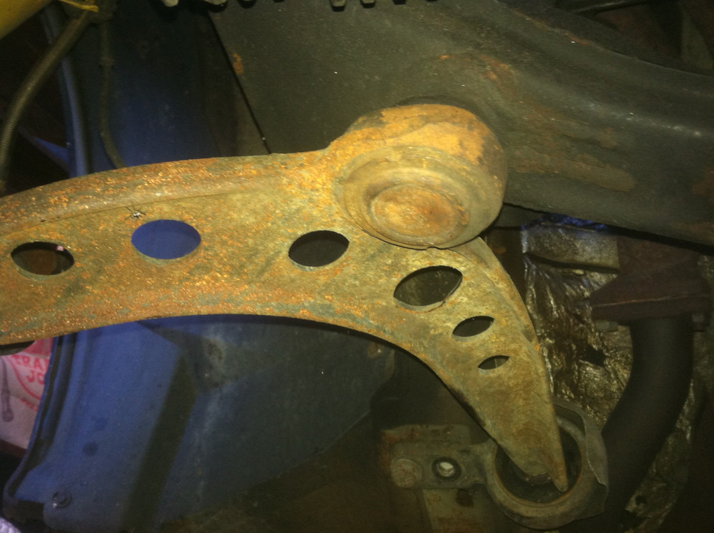Rusty control arms. Rust alone is not a sign of failure but the ball joints and rubber bushing were too worn out.