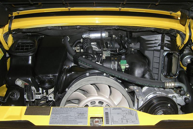 The Porsche flat-six engine.<br /> <br /> 3.6 liter, SOHC, 2 valves per cylinder.<br /> Horsepower: 200 KW / 272 HP @ 6100 RPM<br /> Torque: 330 Nm / 243 lb.ft. @ 5000 RPM<br /> Compression ratio: 11.3:1