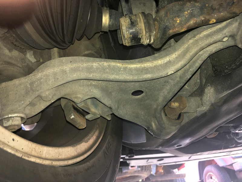 Left control arm from underneath and behind.
