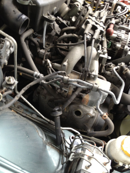 One spark plug with the boot removed. Had to remove the air intake in order to access the spark plugs on this side.