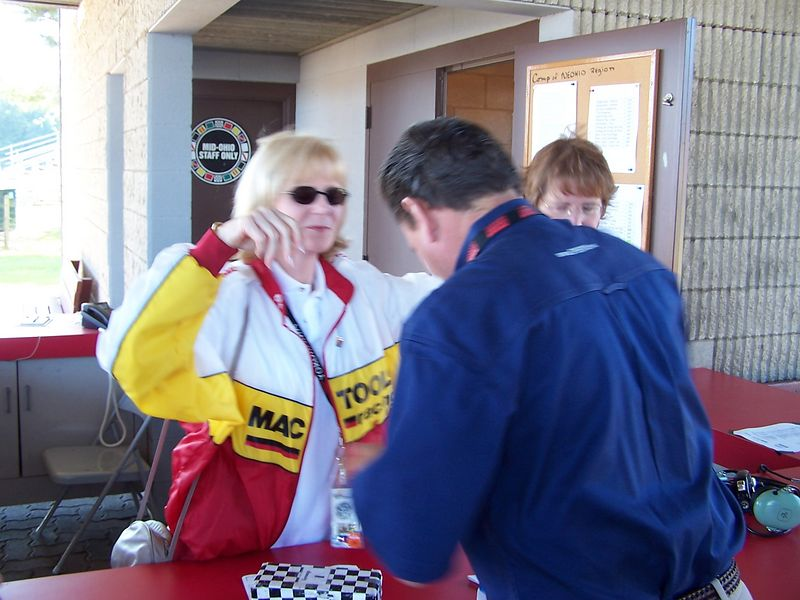 After years of failing to get chicken grilled by Dorsey Schroeder at the OVR Turn 1-1/2 Party at the Runoffs for several years, Mom finally got to meet him.  I ran into Dorsey and Leigh Diffey, and asked Dorsey if he had a minute, explaining Mom's quest.  Mom was actually a little dumbfounded when she turned around, and saw Dorsey walking toward her at  Driver Info.  The camera was a little slow, so it captured the scene post-hug.