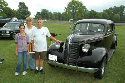 In keeping with the family oriented mission of Right Coast association events, Dave Miller of Cicero is accompanied by wife Carol and granddaughter Tiffany Rawson.  Pictured is Dave's very clean and solid '39 Pontiac 2 Door Flat-back Sedan and his Six Nations Pontiac Car Club award.