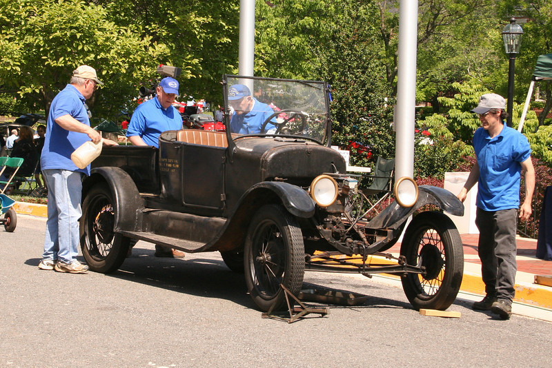 "The Model ""T"" Ford Club prepares to disassemle a Modet T and prepare for the show when they will reassemble it."