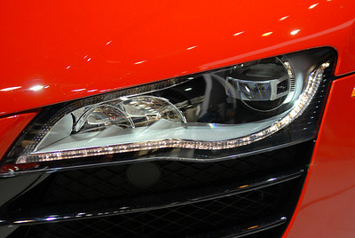 Headlight of the V10 2009 Audi R8. I'm not a huge Audi fan, but this is one good looking car. I also like the jewel-like line of lights Audi has added to the headlights of some of its cars this year.