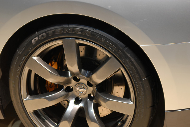 Check out the cross-drilled rotors and 6-piston Brembo brakes on the GT-R. That's some serious stopping power!