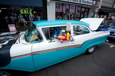 Car Show 006 - 9/12/2010: The cars on display at the 21st Belmont Shore Car Show included this 1957 Ford Fairlane owned by Bob Lee. The car was one of the last to come off a production line at a Ford factory in Long Beach. The sticker said the car sold for $2,281.00 and promised the owner five miles per gallon city and 12 highway. mccormackphotography.com