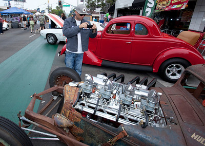 Car Show 028 - 9/12/2010: This was one of the more than 700 cars and trucks on display at the 21st annual Belmont Shore Car Show. The show drew thousands of afficianados  to Second Street in Belmont Shore. Jeremy Brook, a visitor from Vancouver, Washington, is the photographer in the photo. mccormackphotography.com