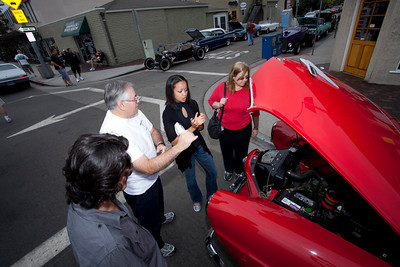 Car Show 025 - 9/12/2010: From left, Daniel Darbani, Al Castillon, Dana Powers and Elaine Castillon discuss the inner working of a 1951 Studebaker on display at the 21st Belmont Shore Car Show. mccormackphotography.com