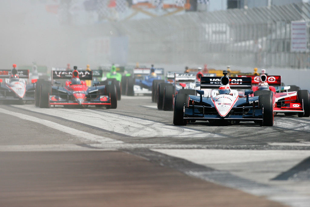 IndyCar drivers race down the straight during the start of the Honda Grand Prix of St. Petersburg.