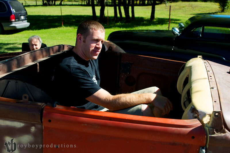 Aaron sitting in his new roadster.