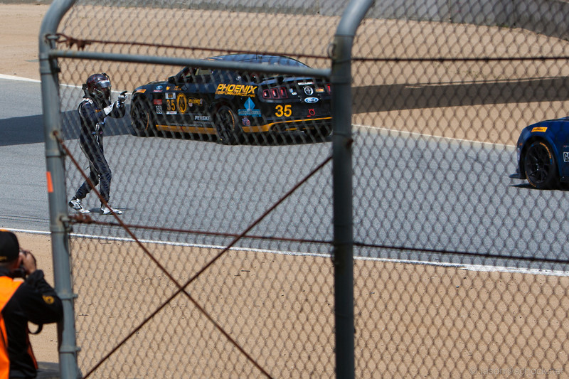 Pointing to the driver who helped him flip his car after The Corkscrew.