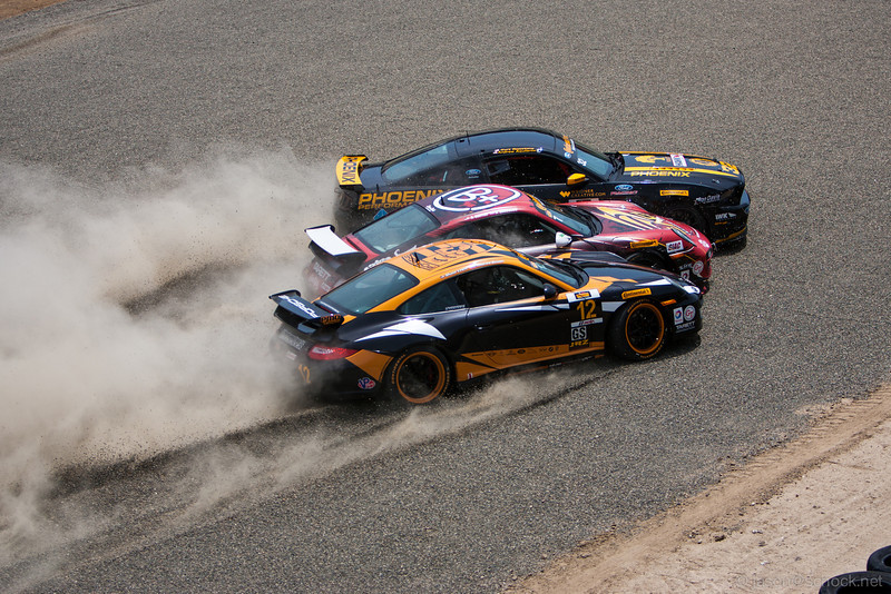 A three-car sandwich on the first lap of the Continental Tire Sports Car challenge race.