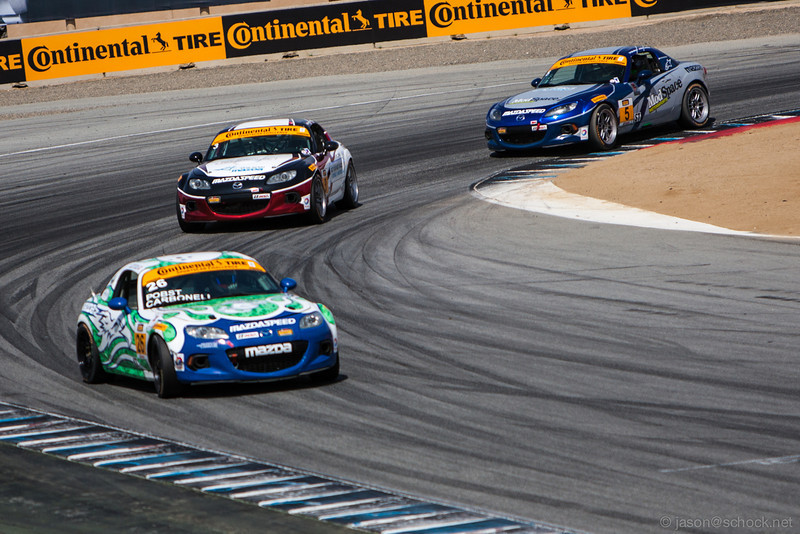 The ST class leaders get a little sideways on the final turn of the Continental Tire race on Saturday.