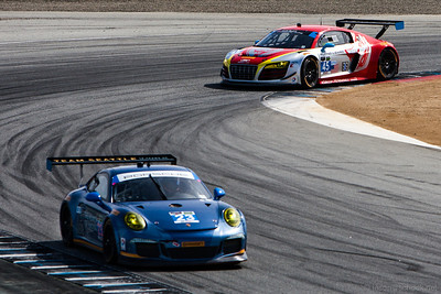 #45 Flying Lizard Audi R8 and the #23 Alex Job Team Seattle Porsche 911 GT America.