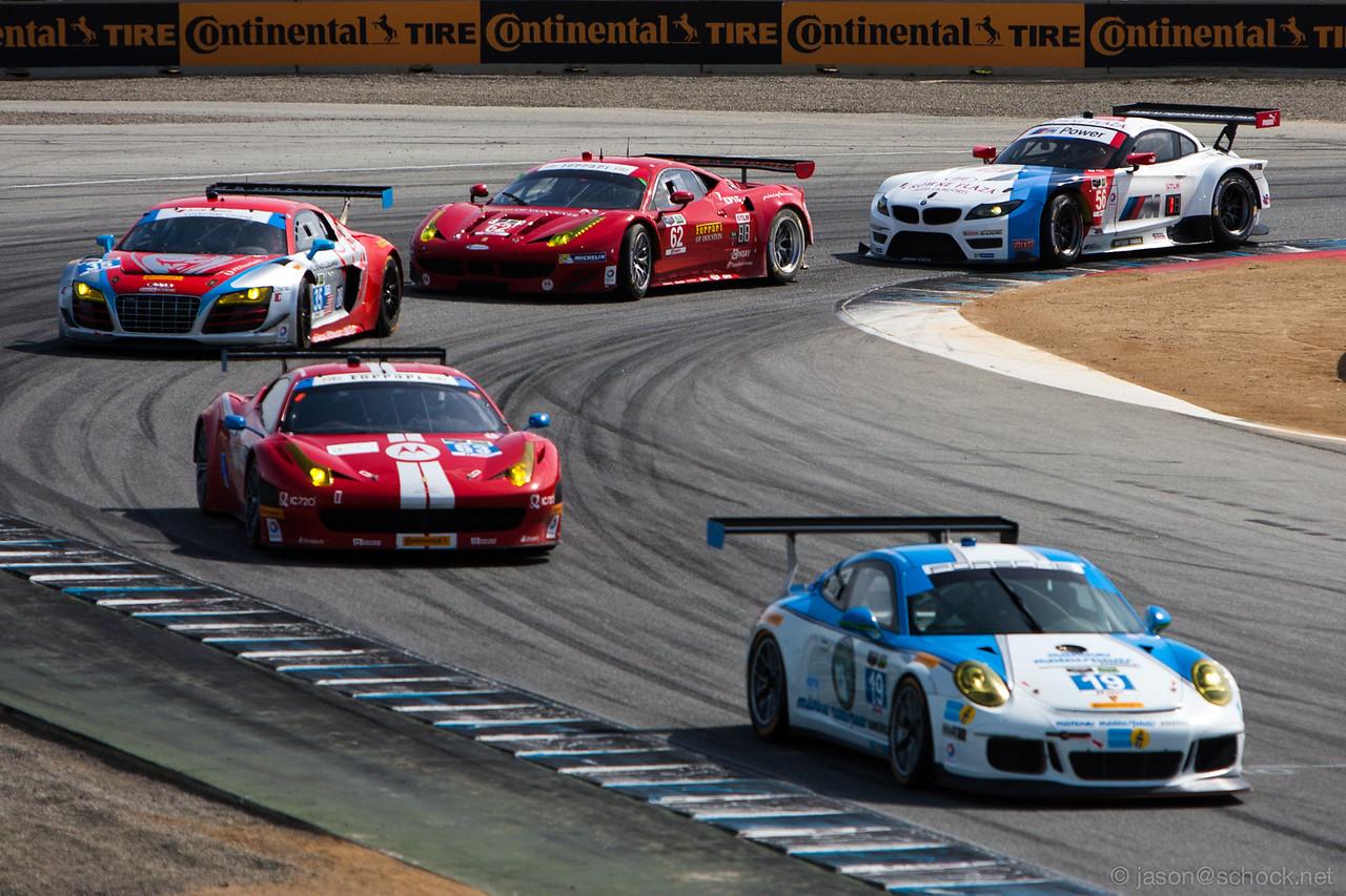 A line of GT cars at Turn 11 at Laguna Seca.