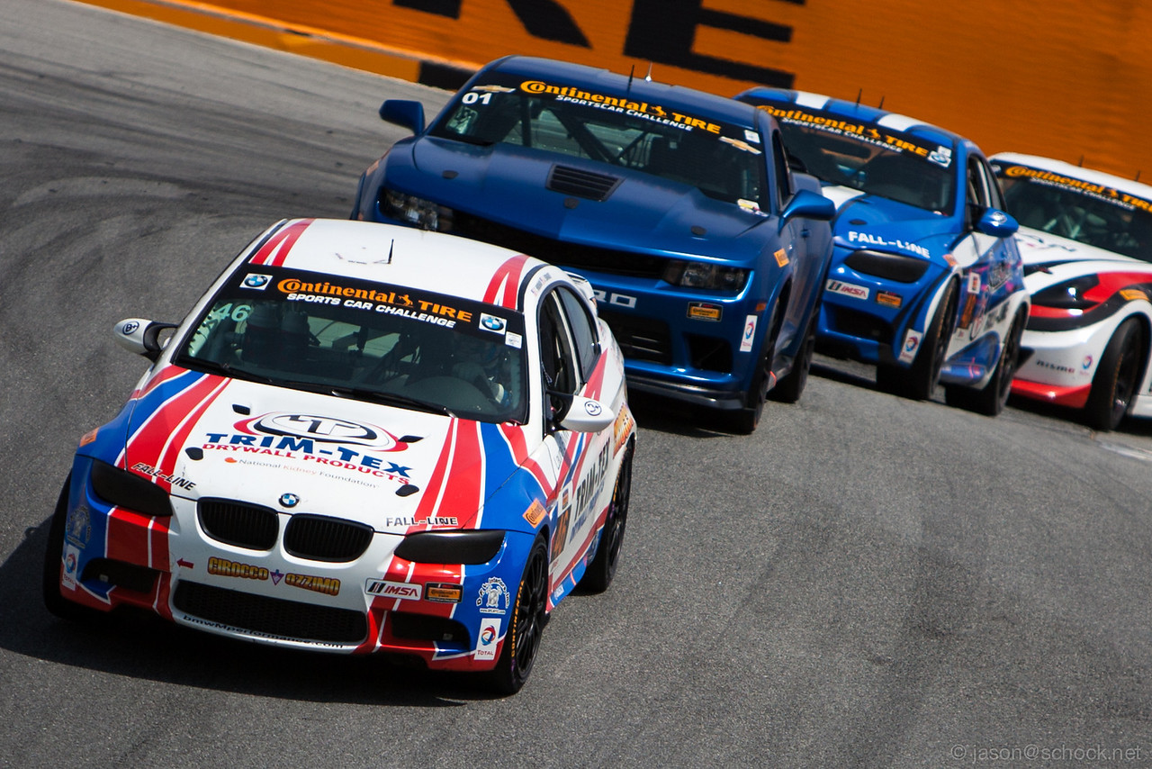 The #46 Fall-Line Motorsports BMW M3 leading the pack through The Corkscrew.