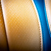 Macro shot showing perforated butterscotch & threading