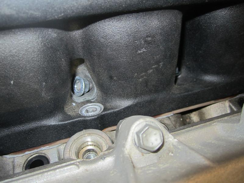 Nut 4 with broken end of Stud 4. Stud 4 broken at manifold.