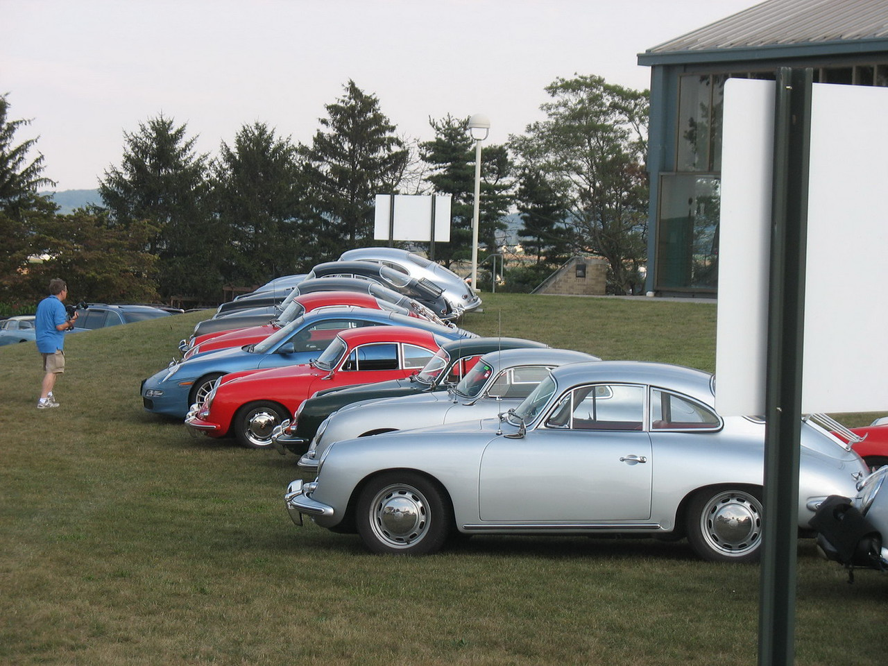 Another row of Porsches, but this one has a later model car in the middle. None of these cars have AC and some people chose to drive newer cars either for comfort or if there was any question about driving the distance in the 356.