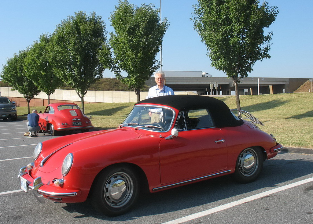 We prepared our 1965 356C Cabriolet for the longest trip it had taken in several decades and drove there on September 4.<br /> <br /> This is Bob next to his car in the parking lot at the Eden Resort. <br /> <br /> The car has never been restored and is mostly original paint, the exceptions being the passenger door and rear bumper, both of which were repainted in the 60's (bumper)or 70's (door). It even has some original stone chips in the paint, but we think it's not bad enough to merit a full restoration.