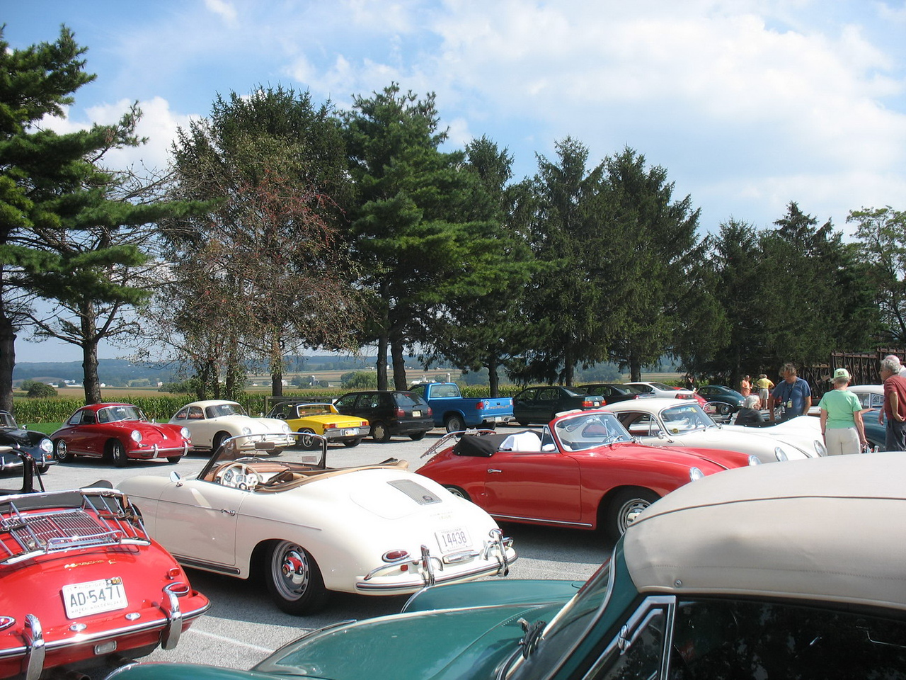 """Late in the afternoon, the entire gathering of nearly 200 cars took a scenic route to the Strasburg Railroad  <a href=""""http://www.strasburgrailroad.com/about-the-railroad.php"""">http://www.strasburgrailroad.com/about-the-railroad.php</a> <br /> <br /> This is part of the parking lot. Our car is the red convertible in the middle with the top down. This was the only time we had the top down on this trip. Too hot in the sun for a long trip and too windy on the Interstates. Then too rainy."""