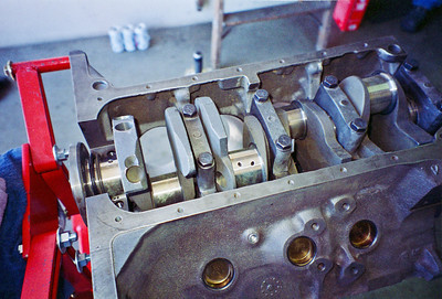 The engine is literally built from the bottom up, beginning with the insertion of the crankshaft. The Cobra Jet block has extra main bearing webbing and thicker main caps than the regular big blocks. Cobra Jet high-nodular–iron crankshaft 1UB. Note main bearing caps have been torqued down but rear main cap has yet to be added.