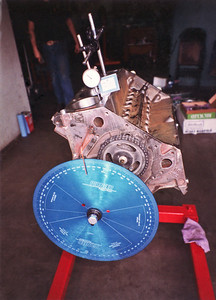 """Degreeing the cam with timimg degree wheel. Note the casting marks on the right side of the block """"68 352"""". Nearly all FE blocks have this '352' in the casting at the front of the block, including the 427s and 428s. This casting identification began with the 352ci engines in 1958 and remained with the FE throughout its service life."""