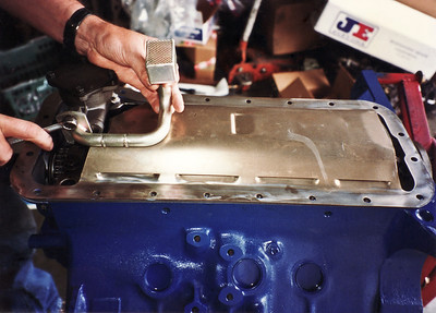 Original Cobra Jet windage tray plus a deep sump, high volume oil pickup. The windage tray is a horsepower adding component, preventing oil aeration and horsepower loss to oil whip at high rpm. Trays were available on late 428 Cobra Jets only.