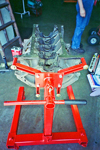 1969 428 Cobra Jet engine has been torn down, hot tanked, and all major machining has been completed. Block is freshly cleaned after machining and mounted on an engine stand for final assembly. Flywheel side is facing photo.