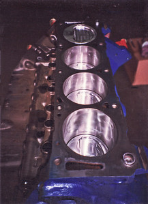 Custom forged JE aluminum pistons (529 grams) have been fitted and look purposeful in the cylinder bores. New moly rings, natch.