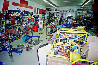 Pat and Mike have the kind of shop that others dream of having. Lots of projects and trophies in the engine building part of the shop. While there is a lot of work in this area note how clean it is. Bryce wears his Shelby World Champions t-shirt.