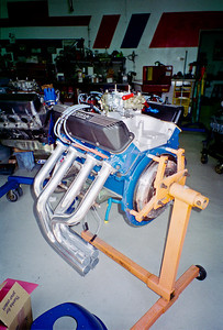The 428 Cobra Jet staging for the dyno room. Note engine plate and flywheel have been added.